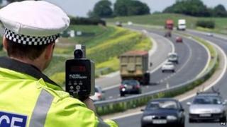 A policeman monitoring traffic