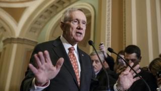 Senate Majority Leader Harry Reid speaks at the US Capitol 2 December 2014