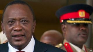 A file photo taken on May 7, 2013 shows Kenyan President Uhuru Kenyatta (L) leaving a hotel in central London,