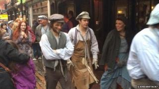 Les Miserable cast in costume after theatre was evacuated