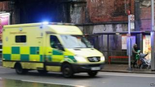 Ambulance passes bus stop outside Waterloo station