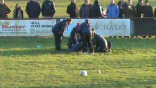 Adam Robson injured on pitch