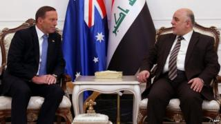 """A handout picture released by Iraq""""s Prime Minister""""s office shows Iraqi Prime Minister Haider al-Abadi (R) and his Australian counterpart Tony Abbott meeting in Baghdad on January 4, 2015"""