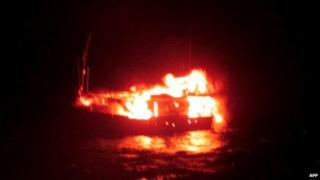 This handout photograph released by The Indian Ministry of Defence on January 2, 2015, is said to show a burning vessel off the coast of the western Indian state of Gujarat in the Arabian Sea early on January 1, 2015.