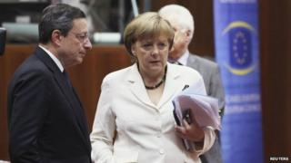 Mario Draghi and Angela Merkel