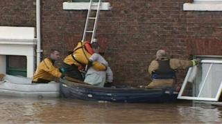 Firefighters saving flooded residents