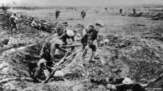 Troops advancing over the top of a trench during WW1