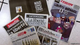 Photo taken in Rennes on January 8, 2015 shows the front pages of French newspapers after the attack by gunmen on French satirical weekly Charlie Hebdo in Paris