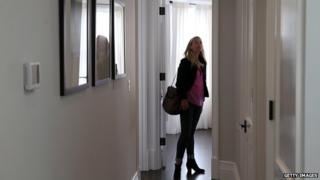 woman looks at flat
