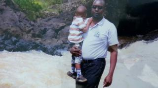 Meschak Yebei with his son in Kenya