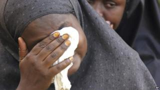 A woman mourns the shooting of a Muslim cleric in Kampala, Uganda - December 2014