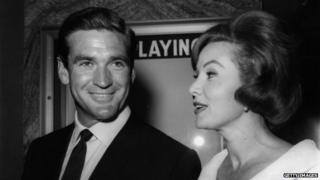 Rod Taylor and actress Rhonda Fleming leaving the premiere of 'Lolita' at LA's Beverly Theatre in 1960