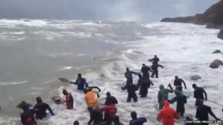 Locals in the sea with nets
