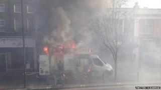Van on fire in street