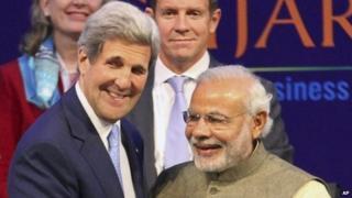 U.S. Secretary of State John Kerry, left, and Indian Prime Minister Narendra Modi attend the Vibrant Gujarat summit in Gandhinagar, India, Sunday, Jan. 11, 2015