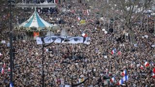 Hundreds of thousands of people marched through Paris on Sunday