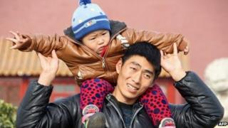 Father and son on visit to Tiananmen Square in Beijing - 5 December, 2013