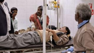 An alcohol poisoning patient receives treatment at the King George Medical College Hospital in Lucknow on January 12, 2015