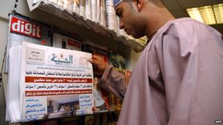 A man looks at the front page of Shabiba newspaper