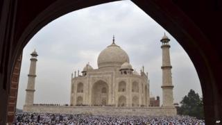 Indian Muslims offer Eid al-Fitr prayer at Shahi Masjid at the famous Taj Mahal, in Agra, India, Monday, Aug. 20, 2012.