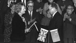 British Prime Minister Margaret Thatcher and Chinese Premier Zhao Ziyang exchange signed copies of the Joint Declaration agreement in December 1984