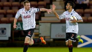 Dunfermline captain Andy Geegan (left) celebrates pulling a goal back for his side with team-mate Faissal El Bakhtaoui.