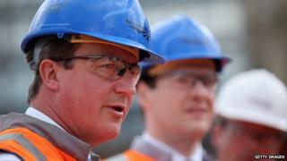 David Cameron in high vis and hard hat