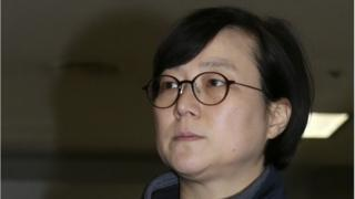 In this photo taken Tuesday, Jan. 13, 2015, Hwang Sun, a former spokeswoman for a now-disbanded leftist party, arrives to participate in determination of a warrant's validity at the Seoul Central District Prosecutors Office in Seoul, South Korea