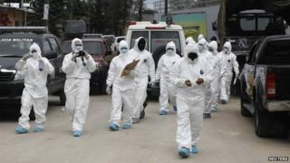 Forensic technicians arrive at the Renacimiento juvenile detention centre in Tamara on 12 January, 2015
