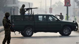 Pakistani soldiers patrol near Army Public School after it reopened in Peshawar. 12 Jan 2015