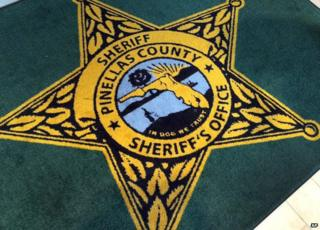 'In dog we trust' misprint on US sheriff's office rug