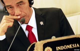 Joko Widodo listens to Japanese Prime Minister Shinzo Abe's speech at the 17th ASEAN-Japan Summit, November 12, 2014