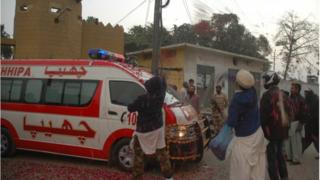 Pakistani residents shower rose petals over an ambulance carrying the body of executed prisoner Muhammad Saeed Awan, a member of the banned Lashkar-e-Jhangvi militant group which is linked to Al Qaeda, outside the central jail in Karachi on January 15, 2015