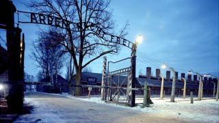 The entrance to Auschwitz-Birkenau concentration camp in Oswiecim, Poland, with the words Arbeit Mach Frei (work makes you free) on the gates. It is now part of The Auschwitz-Birkenau State Museum