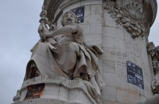 "A statue on Place de la Republique, Paris, symbolically ""gagged"" by protesters, 10 January 2015"