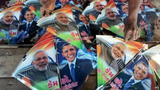 An Indian kite vendor shows kites with pictures of US President Barack Obama and Indian Prime Minister Narendra Modi on them, in a market in Bhopal, India, 10 January 2015.