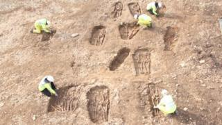 An aerial view of archaeologists working on the Dark Age cemetery found at Hinkley Point