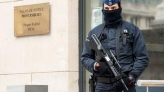 A policeman guards the Belgian Federal Prosecutor's office in Brussels, 16 January 2015