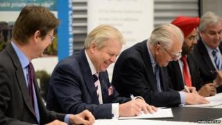 Government minister Greg Clark (left) signed the deal at Harper Adams University