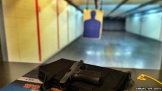 A handgun is seen on a counter at a firing range in the US on 26 November 2014