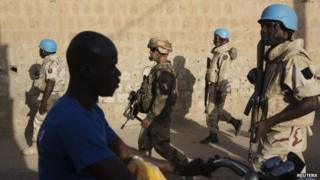 File photo: French soldiers and United Nations peacekeepers from Burkina Faso patrol in Timbuktu, Mali, 5 November 2014