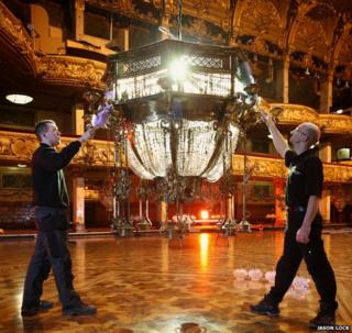Jordan Tierney and Andy Hunter dusting a chandelier at Blackpool Tower Ballroom