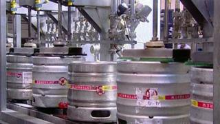 Beer kegs on production line