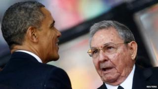 Obama and Castro at Mandela's funeral, 10 December 2013