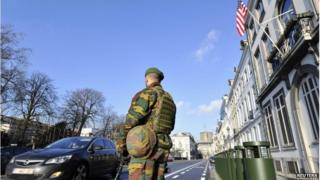 A Belgian soldier guards outside the U.S. Embassy in Brussels near the Belgian Parliament on 17 January.