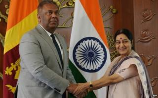 Sri Lankan Foreign Minister Mangala Samaraweera with Indian Foreign Minister Sushma Swaraj before a meeting in Delhi on January 18, 2015