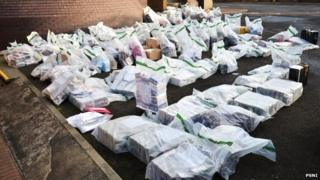 The seized DVDs packed into evidence bags