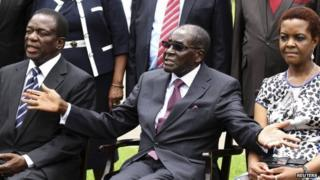 Zimbabwe's President Robert Mugabe (centre) sits with his wife Grace Mugabe and Emmerson Mnangagwa (left) - 12 December 2014