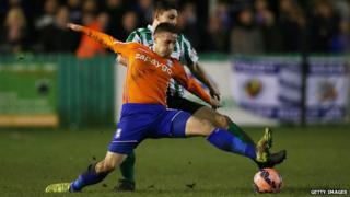 Birmingham City defender Mitch Hancox vies with Blyth Spartans' Jordan Watson