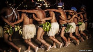 Members of the Dessana village dancing